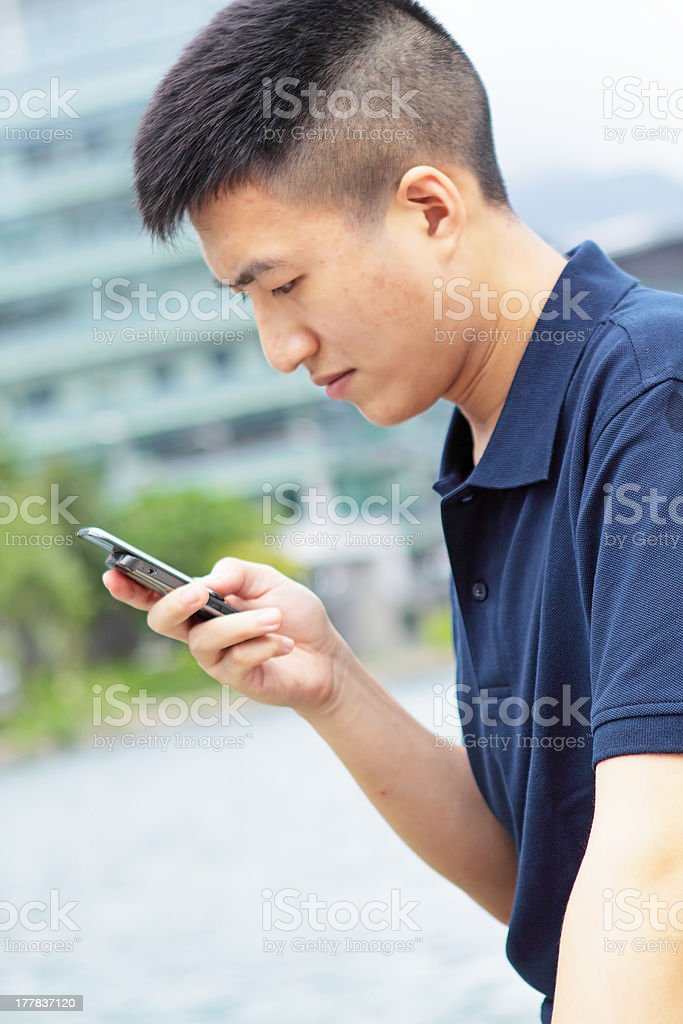 Casual asian businessman texting royalty-free stock photo