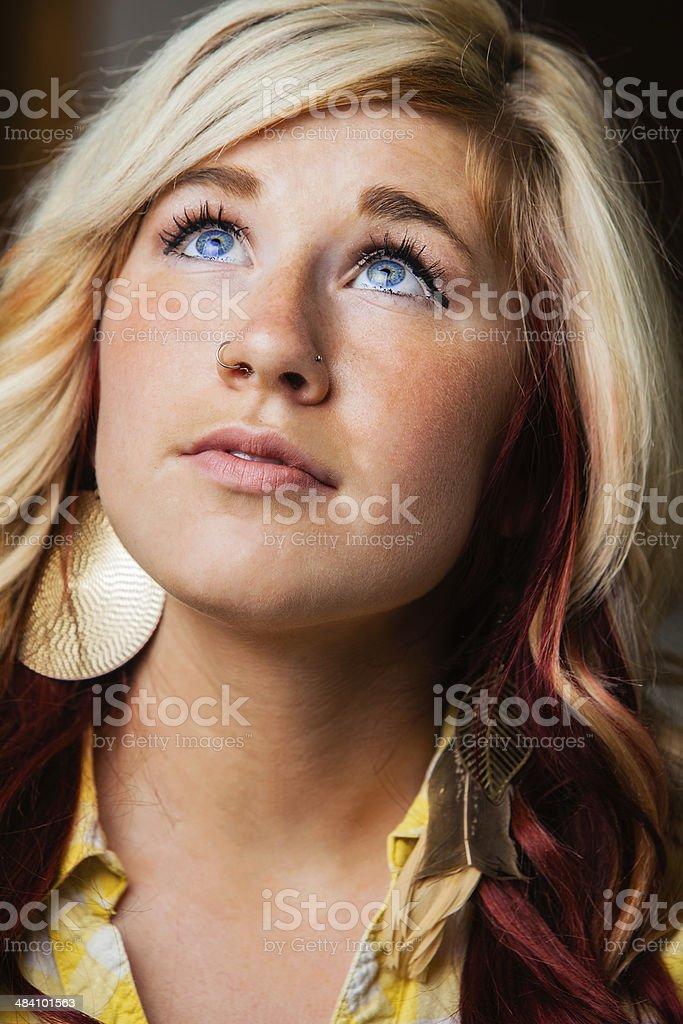 Casual Beauty Blond Looks Skyward Expectantly stock photo