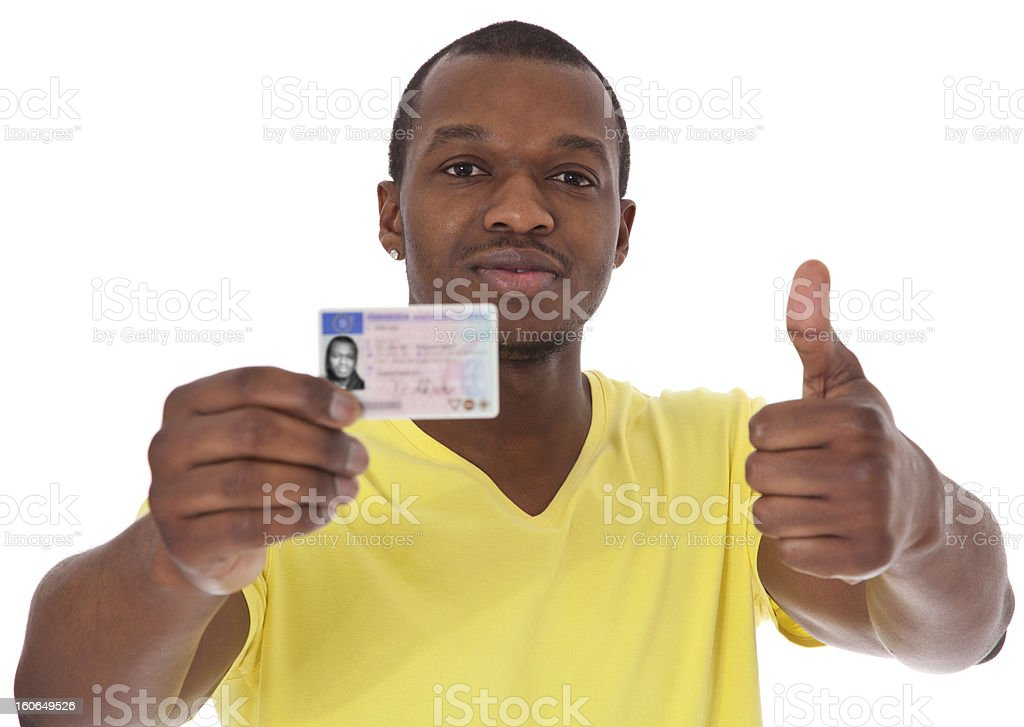 Casual black guy proudly showing his drivers license stock photo