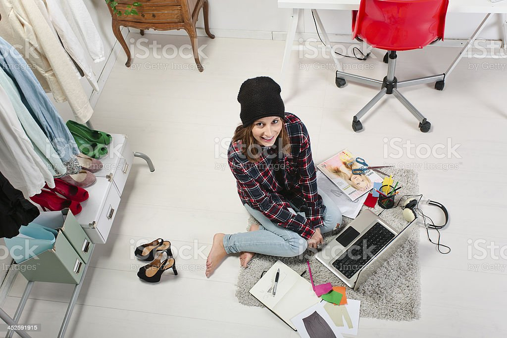 Casual blogger woman working in her fashion office. stock photo