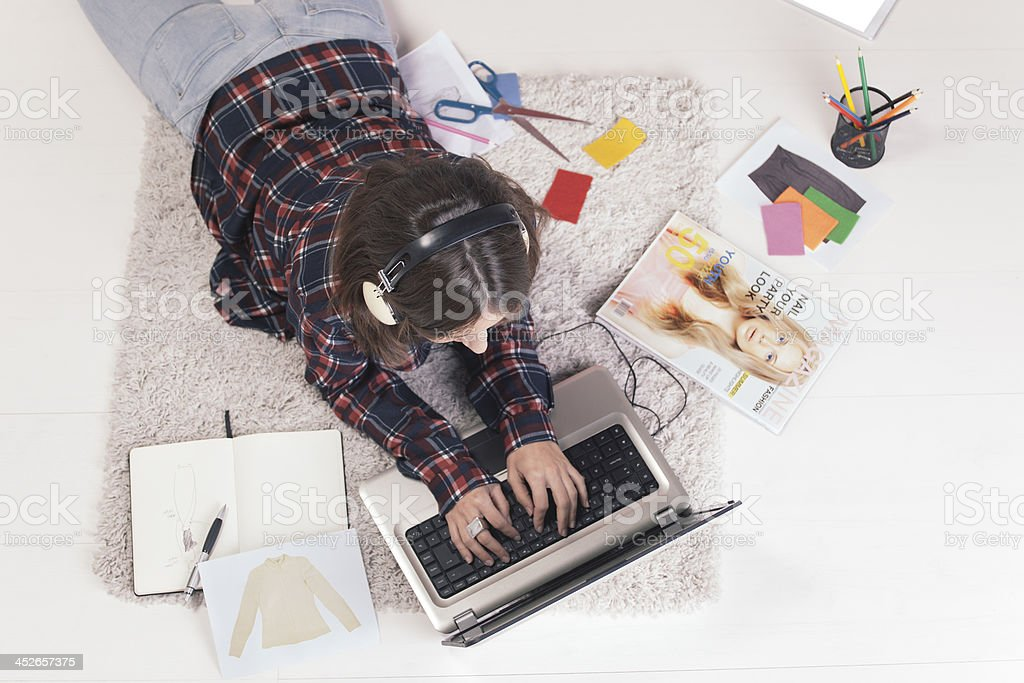 Casual blogger woman working with laptop in fashion office. stock photo
