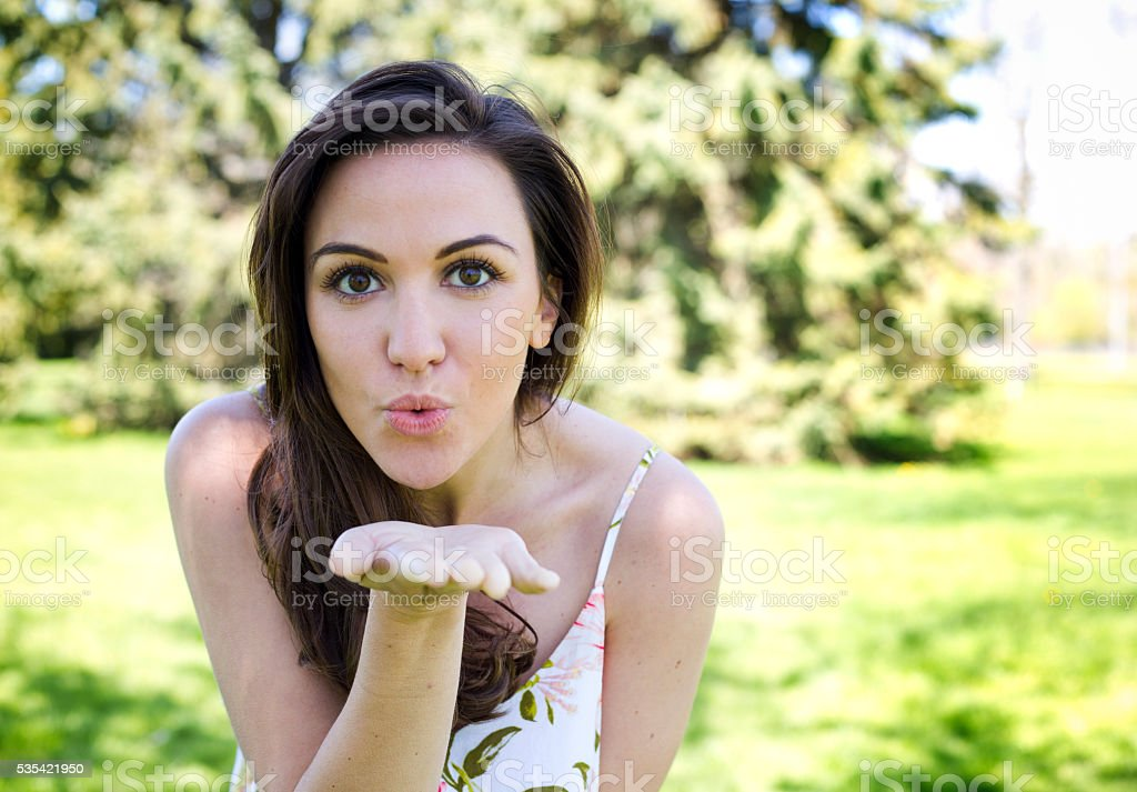 casual brunette outdoors stock photo