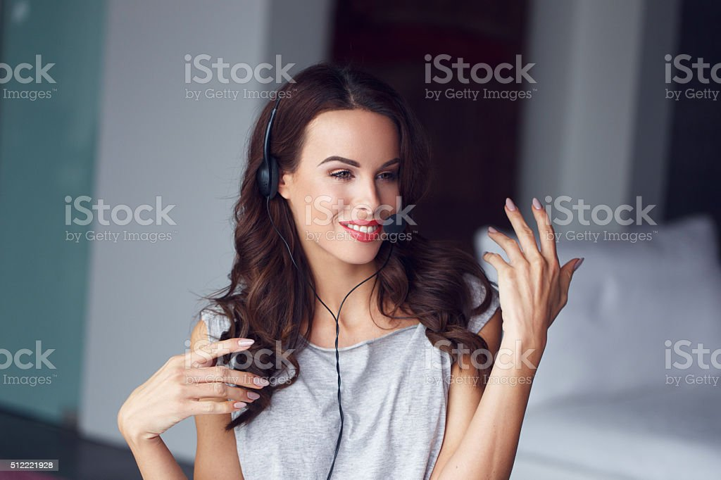 Casual brunette woman with headset explain online stock photo