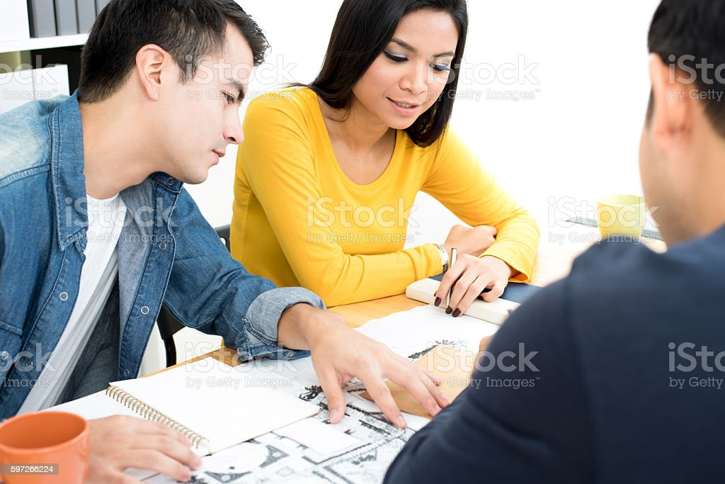 Casual business people (or architects) discussing work stock photo