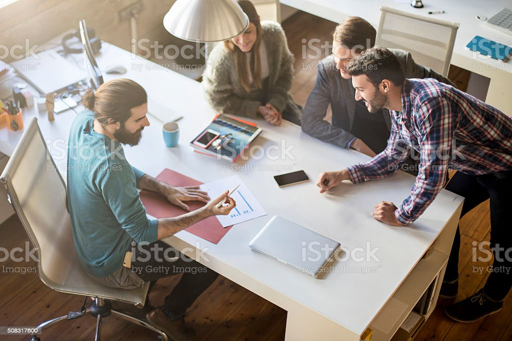 Casual business people on a meeting at the office stock photo