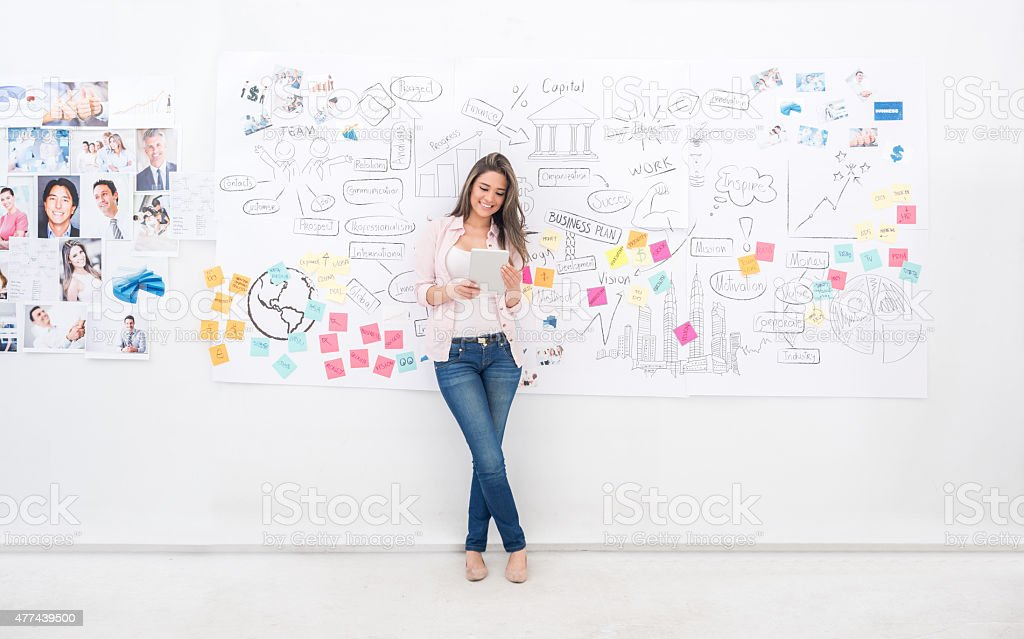 Casual business woman using a tablet computer stock photo