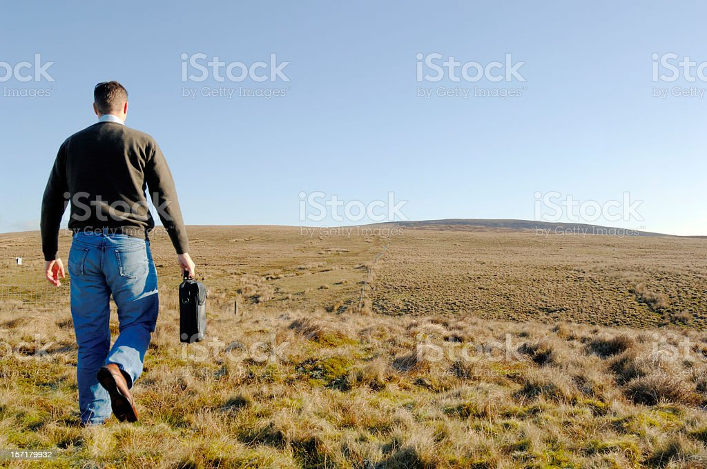 Casual businessman in field, concept freedom, space, uncertain f royalty-free stock photo