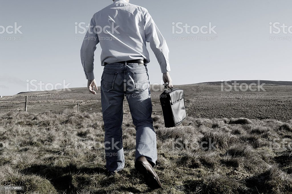 Casual businessman in field, concept lost, decisions, uncertain royalty-free stock photo