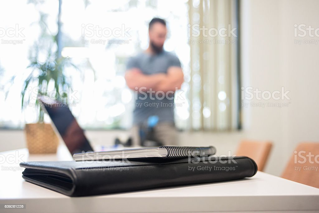 Casual Businessman Leaning Against the Office Window stock photo