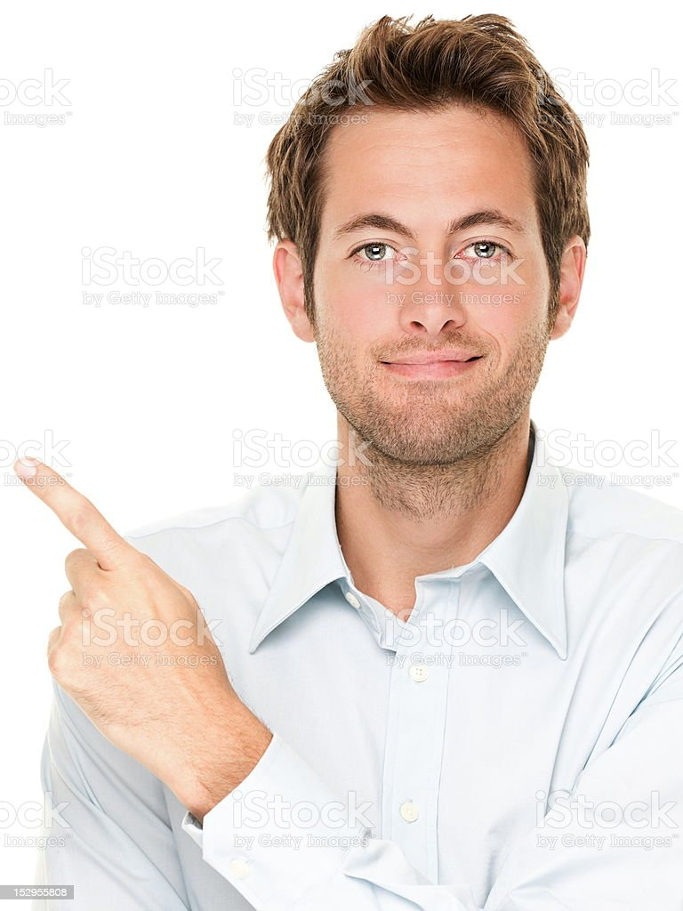 Casual businessman pointing stock photo