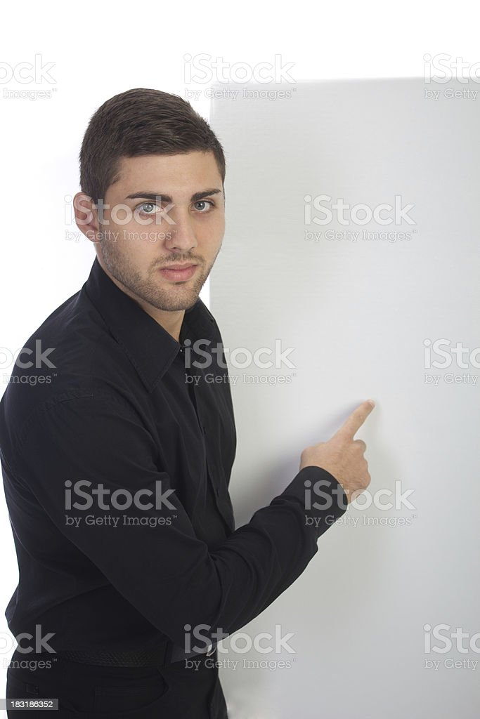 Casual businessman pointing royalty-free stock photo