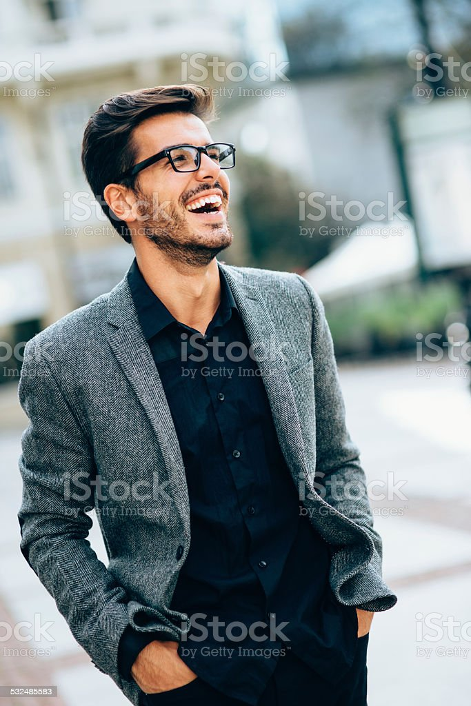 Casual businessman smiling outdoors stock photo