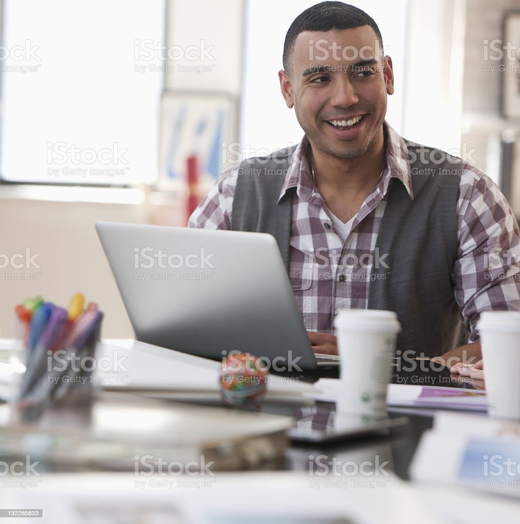 Casual businessman smiling sideways royalty-free stock photo
