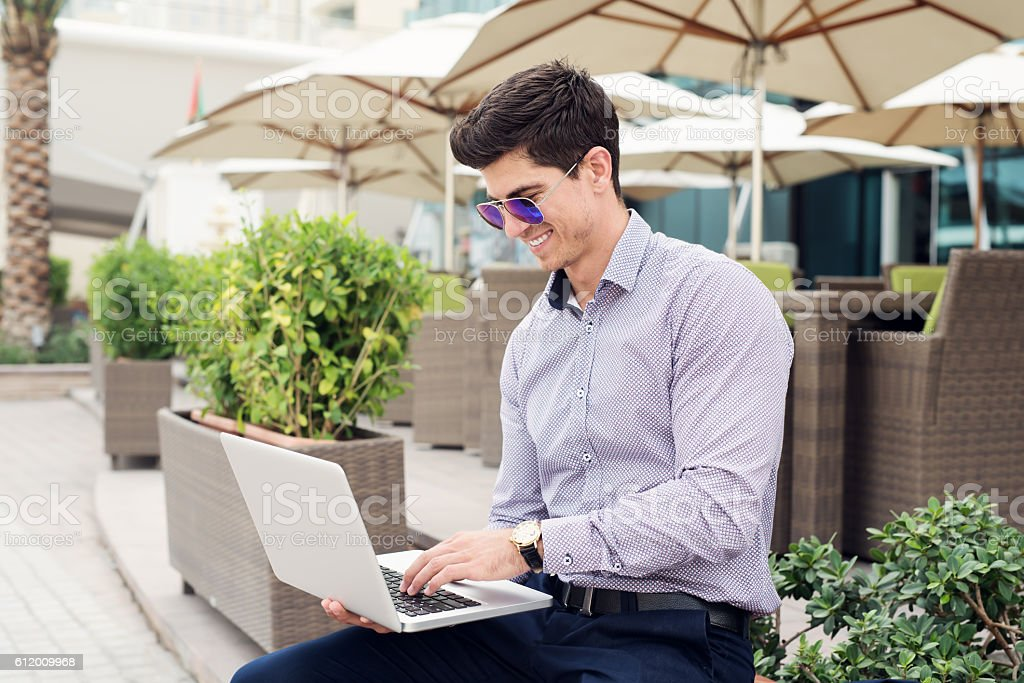Casual businessman typing on his laptop. stock photo