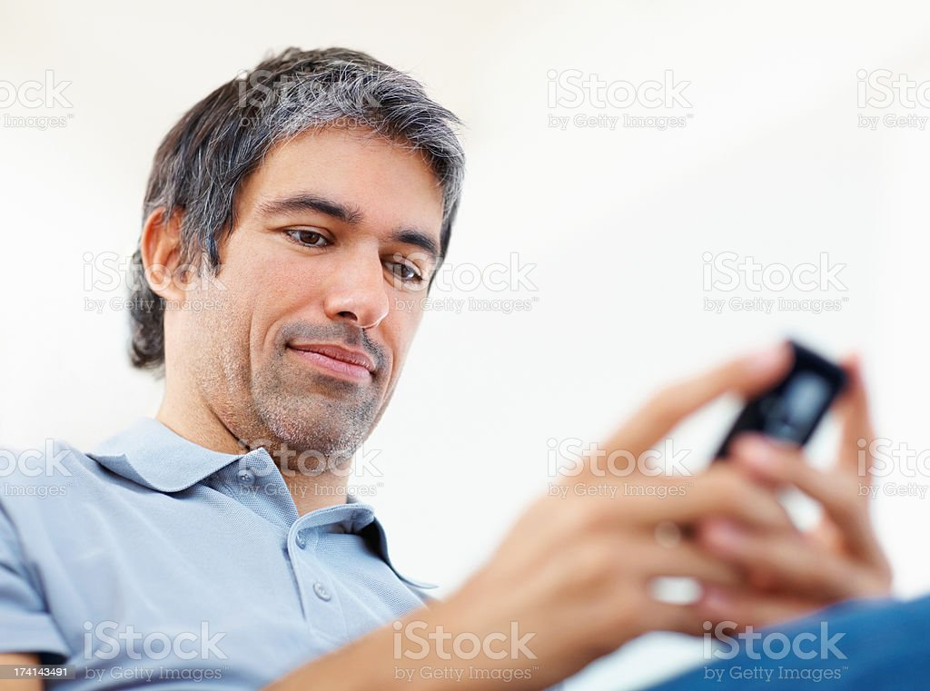 Casual businessman typing text message on his cell phone royalty-free stock photo