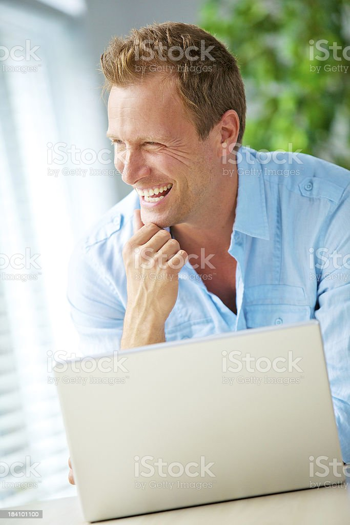 Casual businessman using laptop royalty-free stock photo