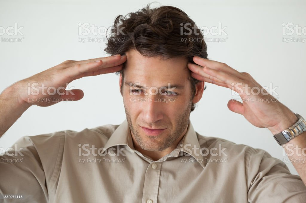 Casual businessman with a headache stock photo