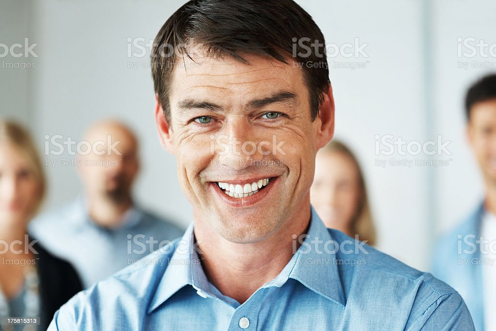 Casual businessman with his business colleagues stock photo