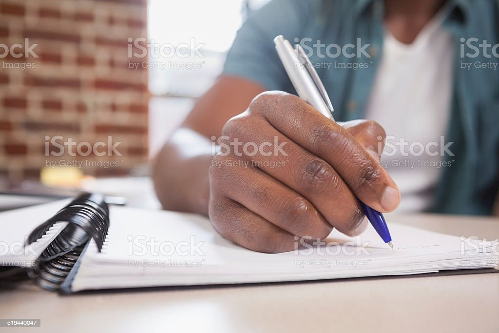 Casual businessman working at his desk stock photo