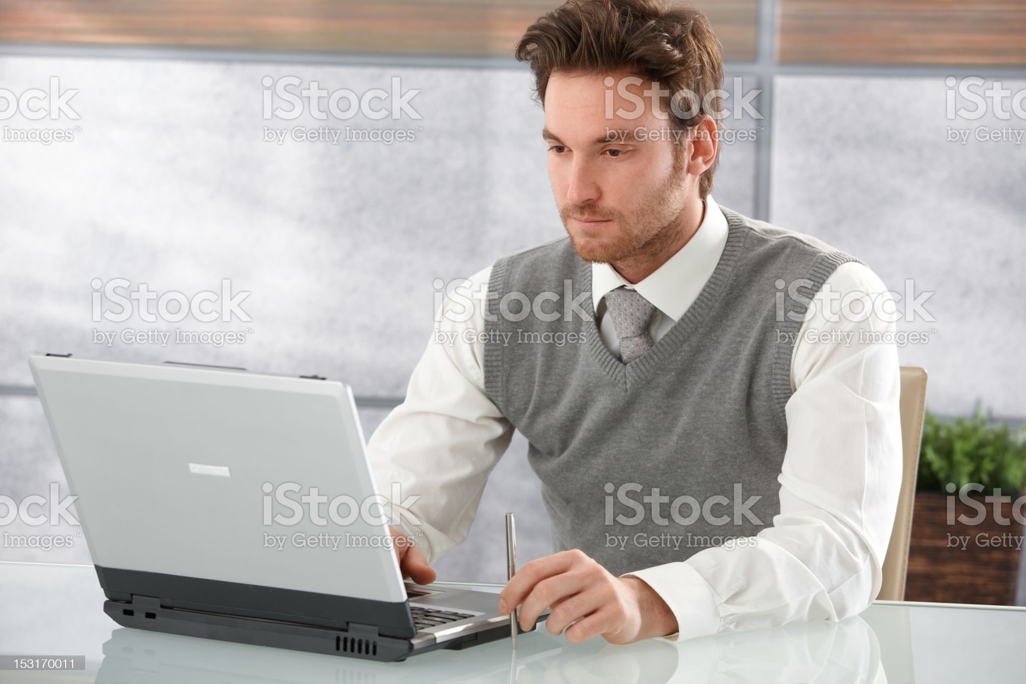Casual businessman working on laptop royalty-free stock photo