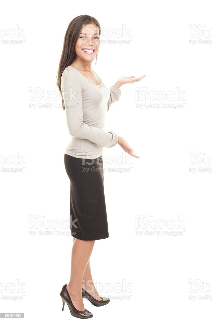 Casual businesswoman showing copy space stock photo
