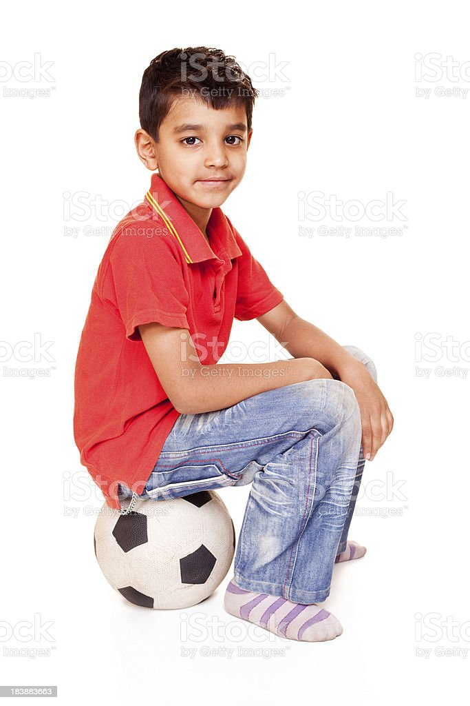 Casual Cheerful Little Indian Boy Isolated White with Soccer Football royalty-free stock photo