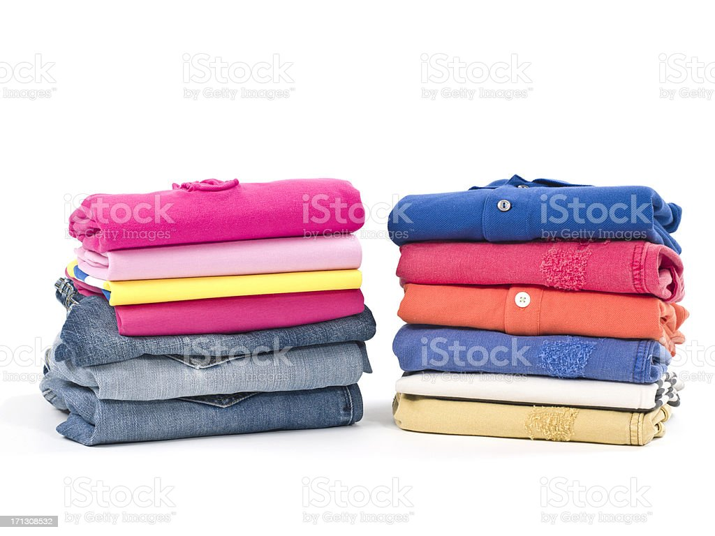 Casual clothes folded in pile on white stock photo
