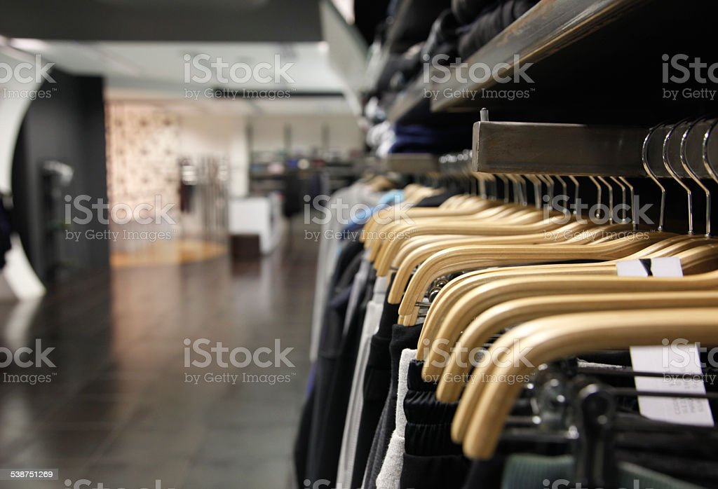 casual clothes in self  inside  store stock photo