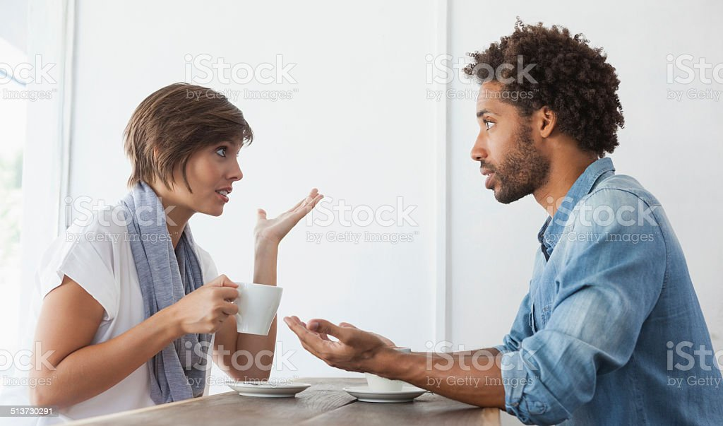 Casual couple having coffee together stock photo