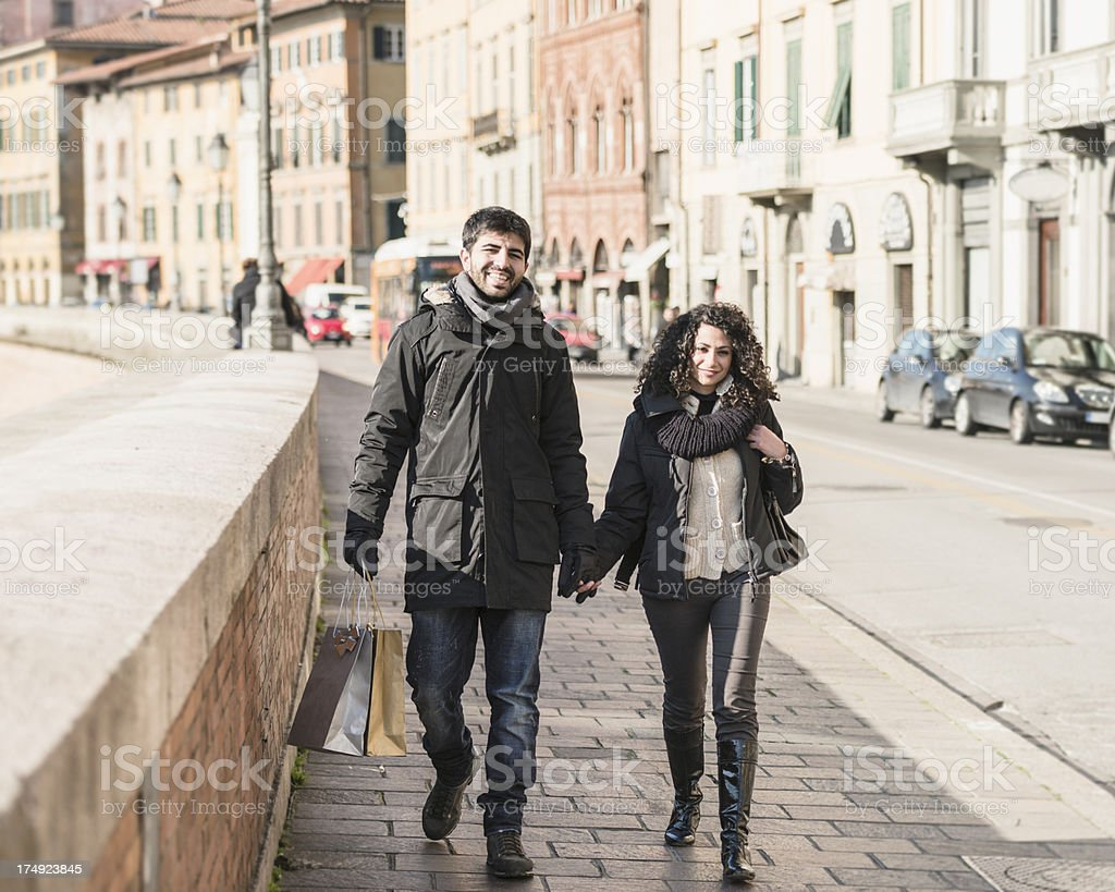 casual couple of lover walking on the city in winter royalty-free stock photo