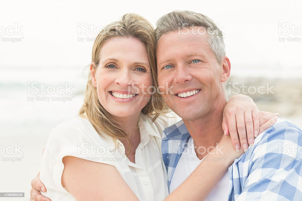 Casual couple smiling at camera stock photo