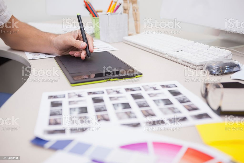Casual designer using a graphics tablet stock photo