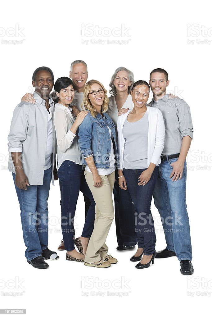 Casual diverse group of friends standing together; studio shot royalty-free stock photo