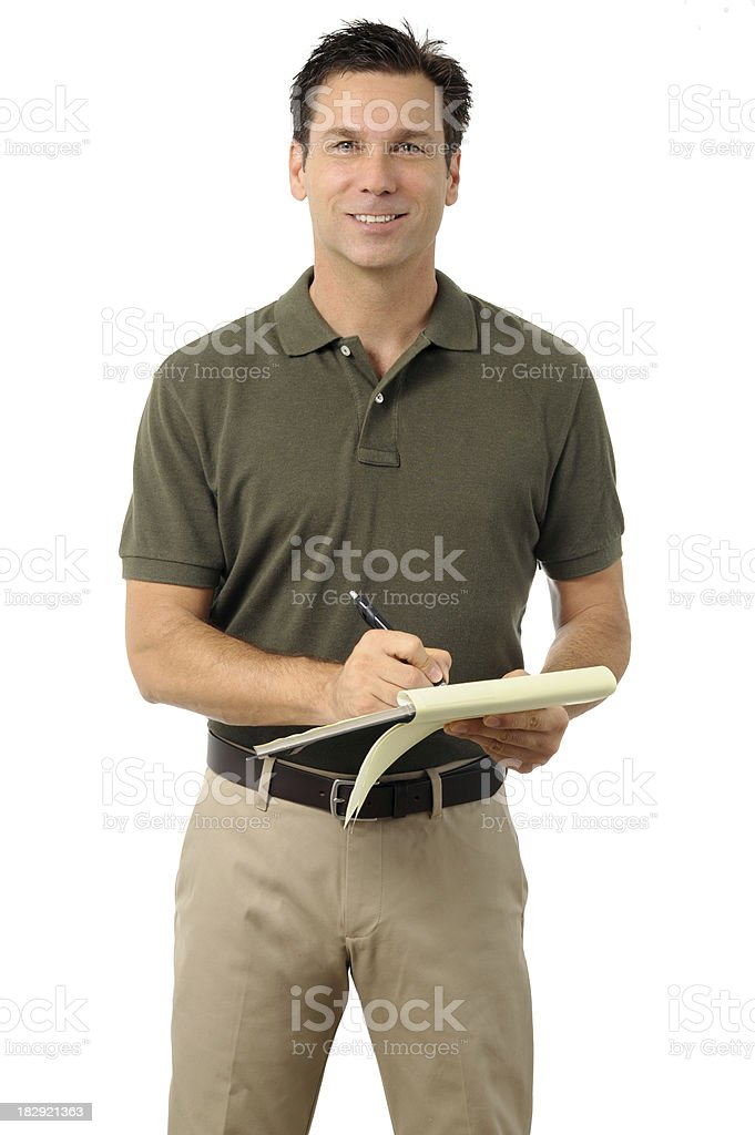 Casual Dress Businessman Writing on Clipboard royalty-free stock photo