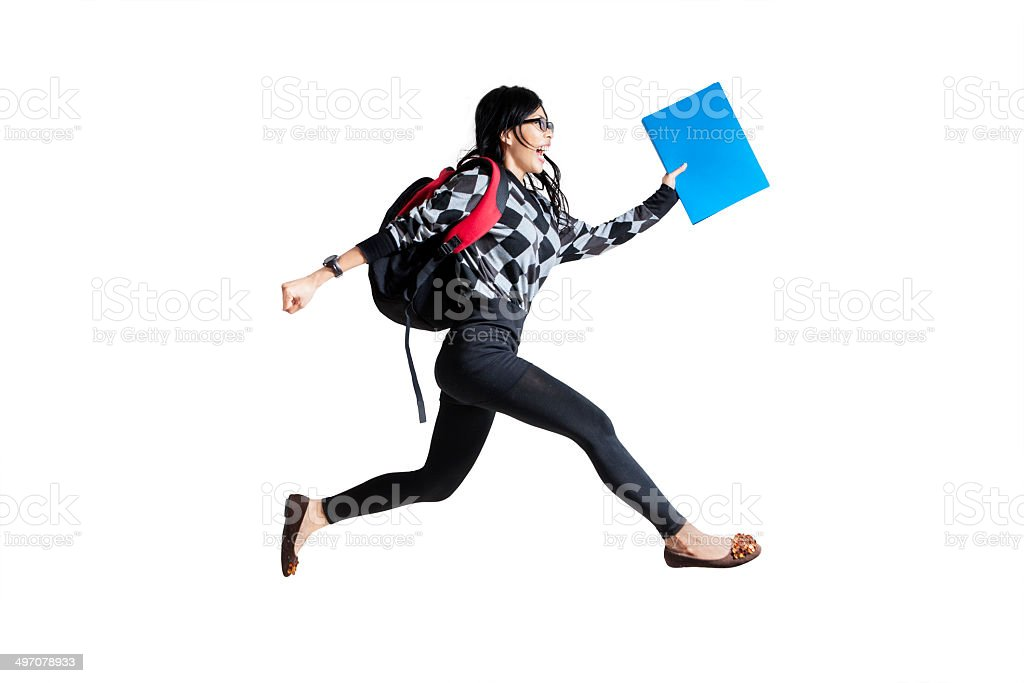 Casual female student running stock photo