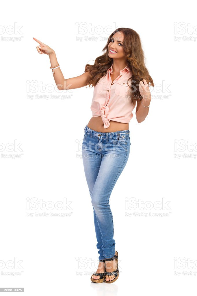 Casual Girl In Jeans Pointing stock photo
