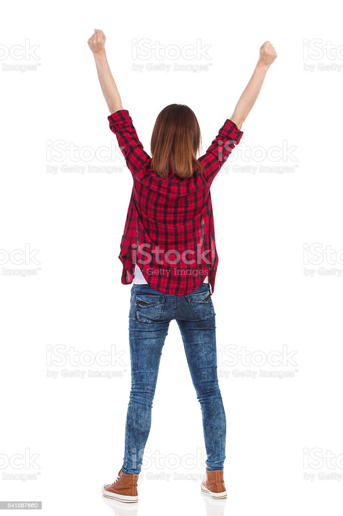 Casual Girl With Arms Raised Rear View stock photo