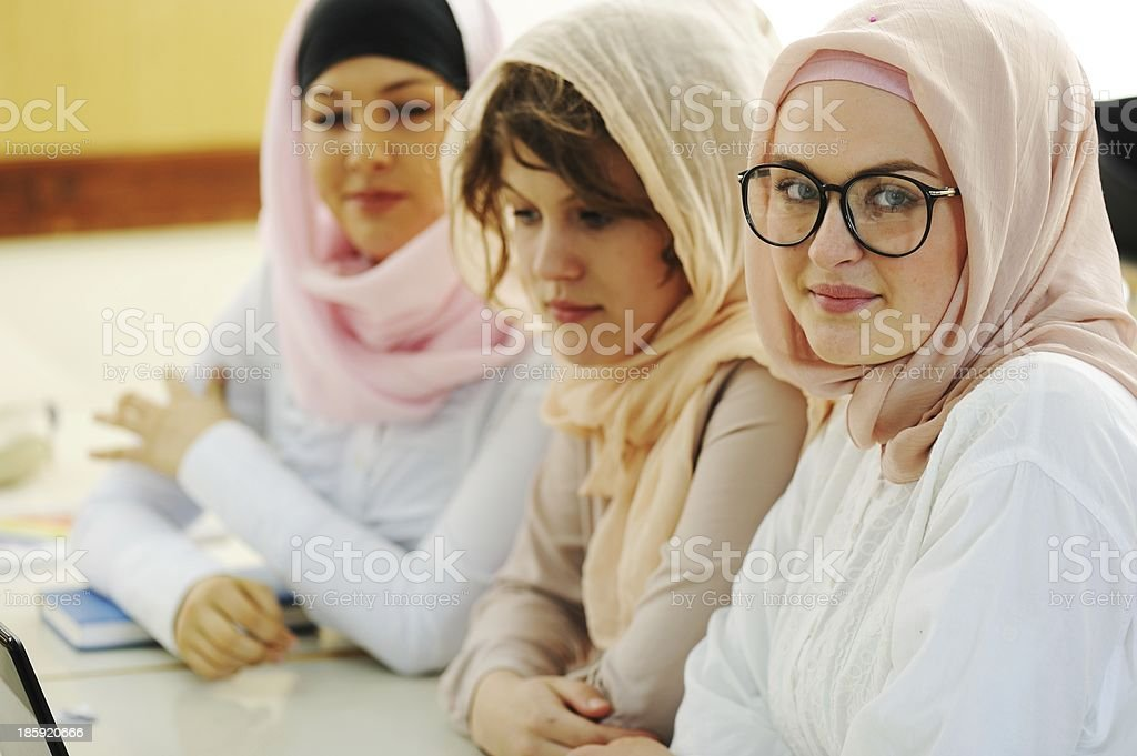 Casual group of students looking happy and smiling stock photo