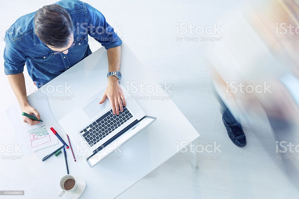 Casual Guy workin on laptop stock photo
