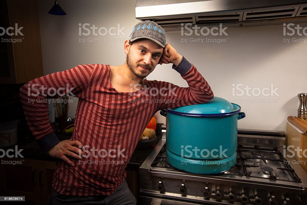 Casual Home Cook with Enamel Cooking Pot stock photo