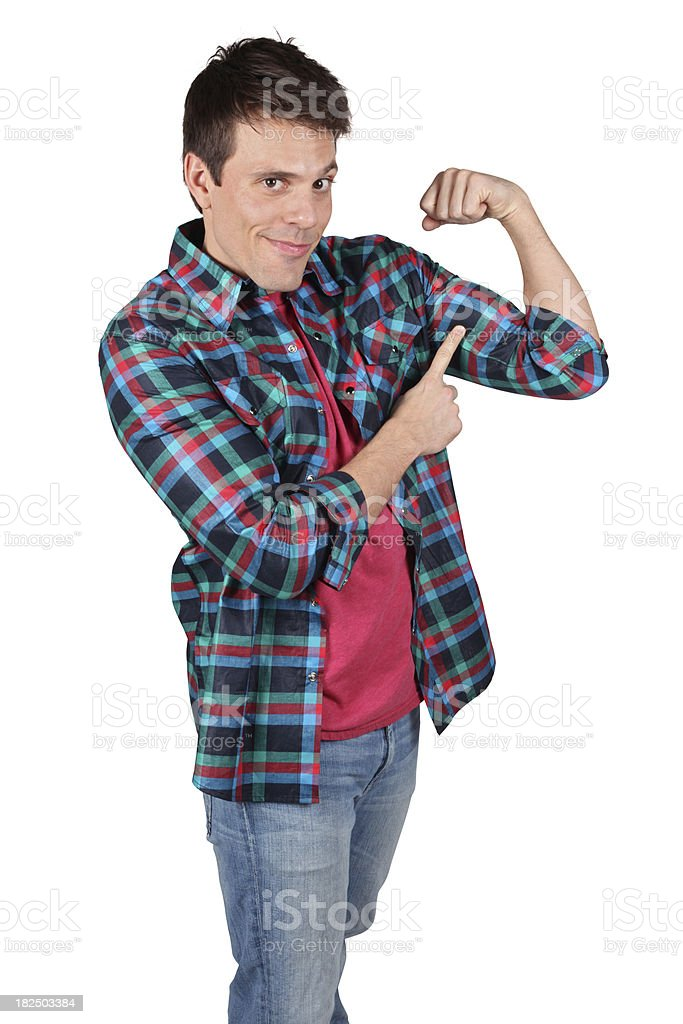 Casual male pointing to flexed muscle royalty-free stock photo