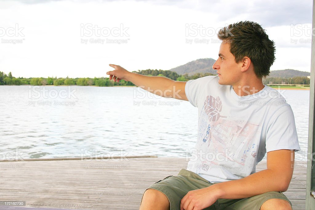 Casual Male - pointing to the left stock photo