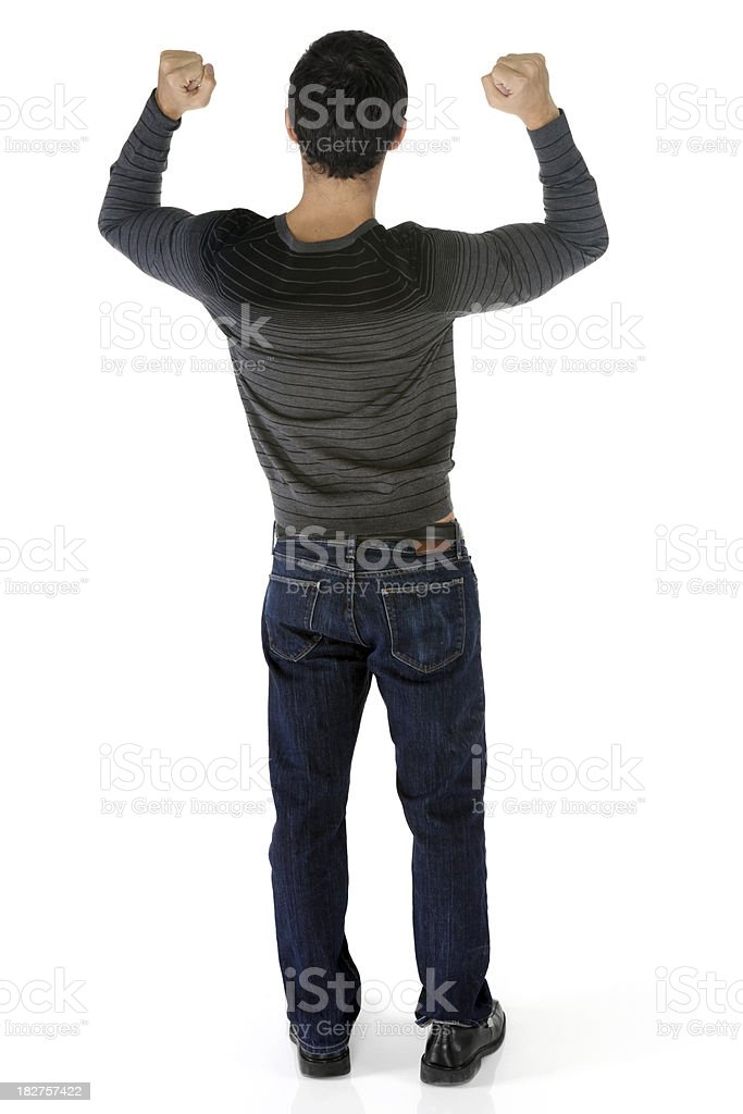 Casual male rear view arms up celebrating stock photo