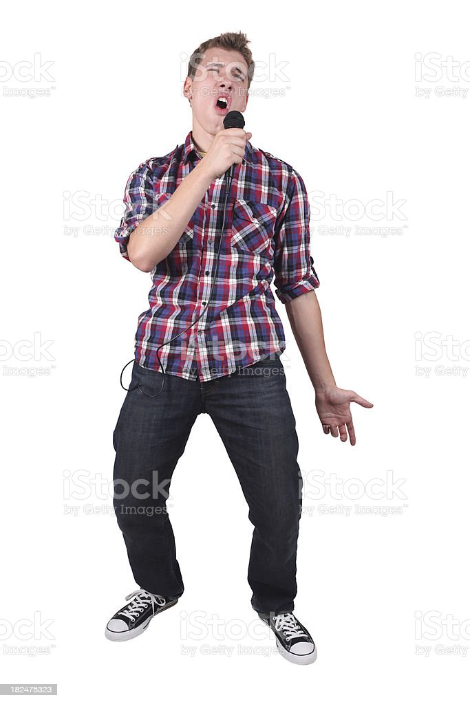 Casual male singing into microphone stock photo