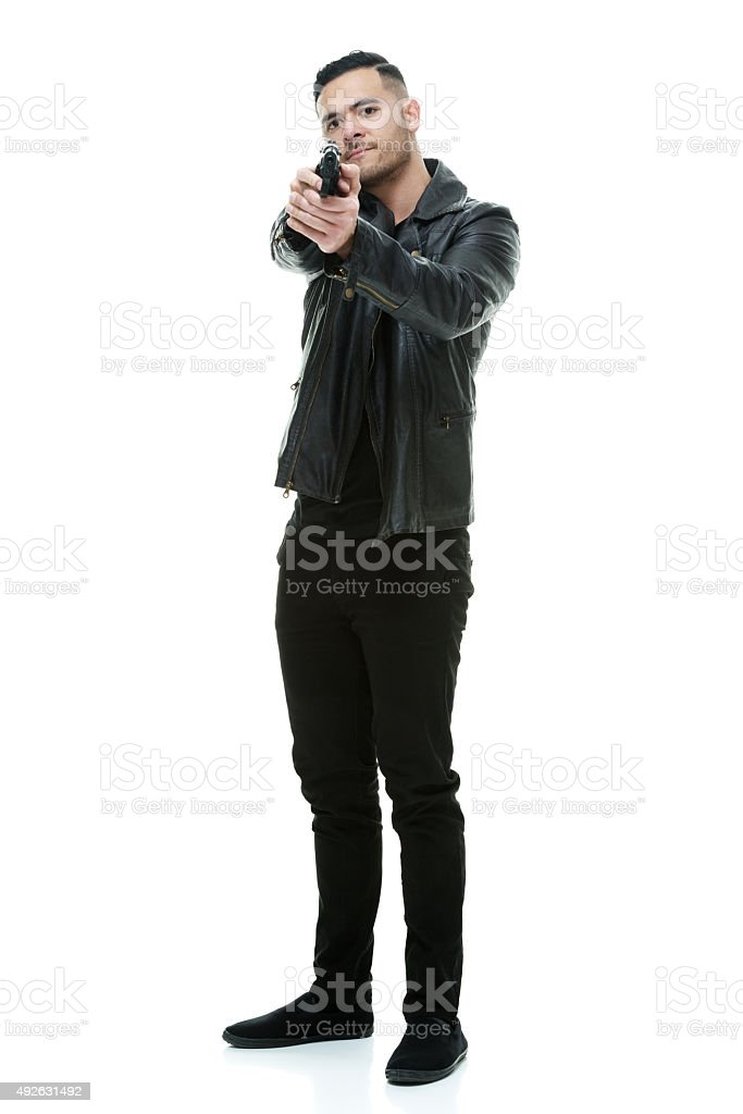 Casual man aiming with gun stock photo