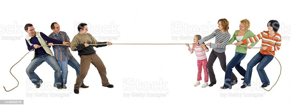 Casual man and woman playing tug of war - isolated stock photo