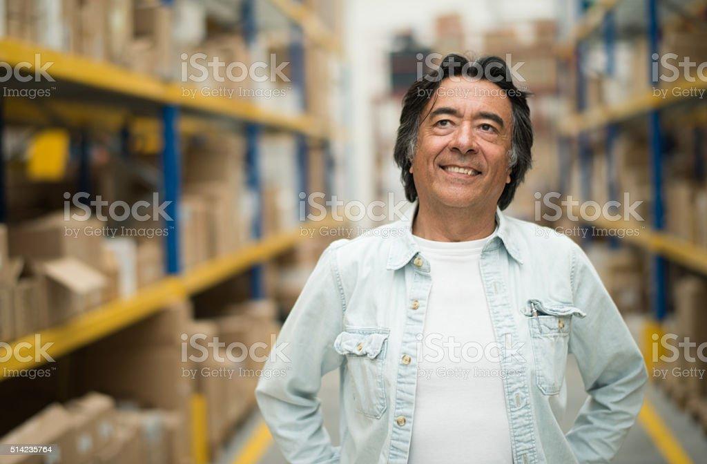 Casual man at a warehouse stock photo