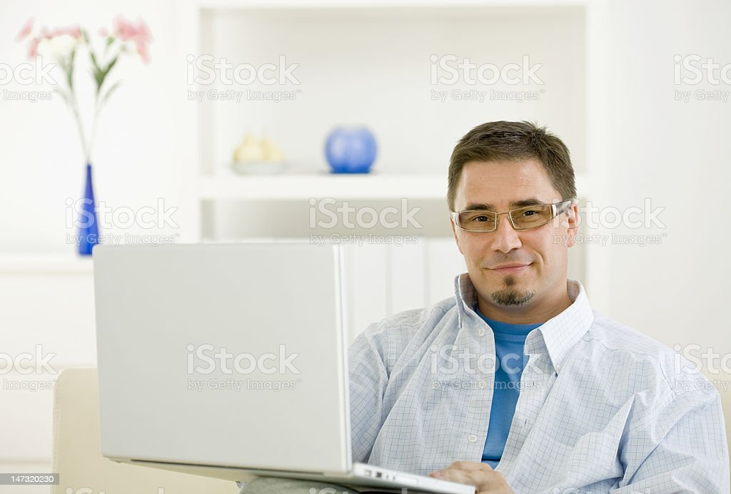 Casual man browsing internet royalty-free stock photo