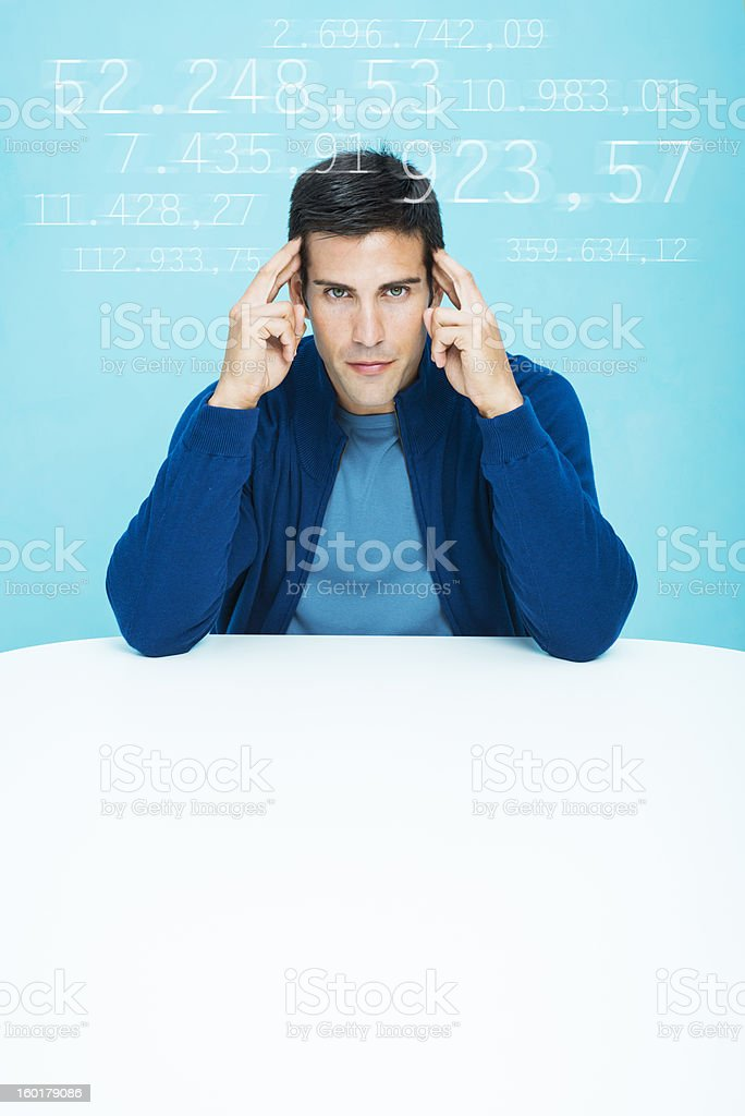 Casual man concentrated in calculations stock photo