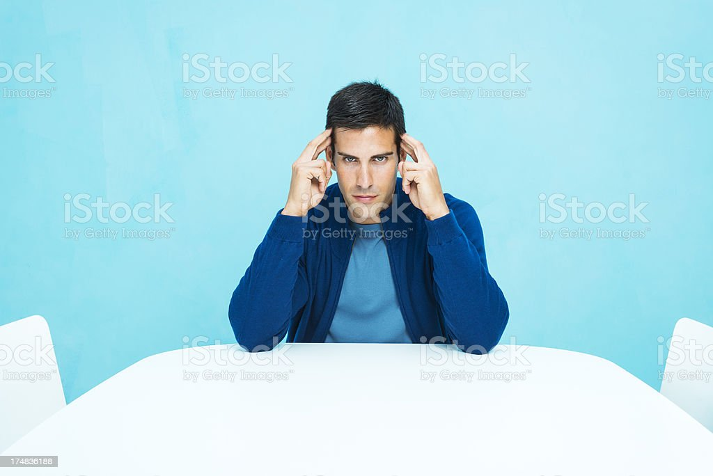 Casual man concentrating stock photo